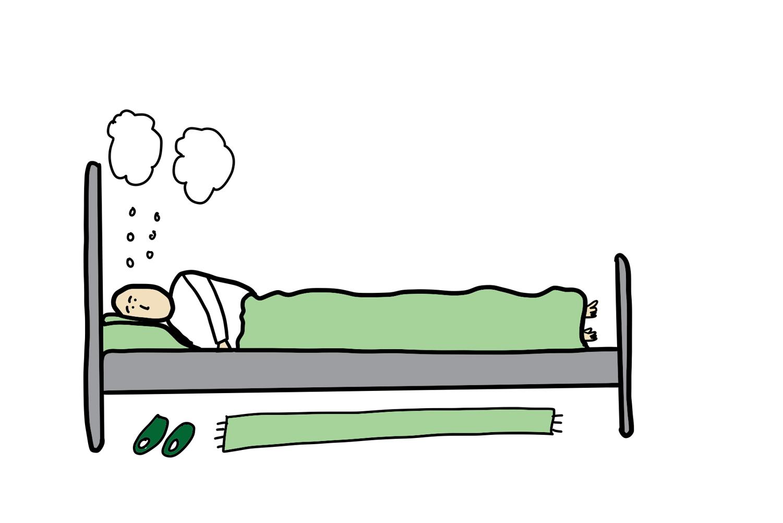 person i seng ligger og tenker